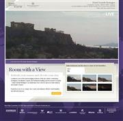 ギリシャのライブカメラ:首都アテネの歴史あるホテル「ホテル・グランド・ブルターニュ」から見たシンタグマ広場とアクロポリスの今の景色