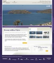 ギリシャのライブカメラ:クレタ島東部,エルンダにある高級リゾート,「ブルー・パレス・リゾート&スパ」から見た海岸の今の景色